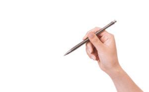 ペンを持っている手